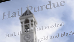 Hail Purdue text with the Bell Tower behind it